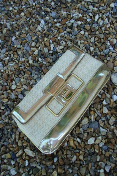Anya Hindmarch rafia and gold leather clutch bag